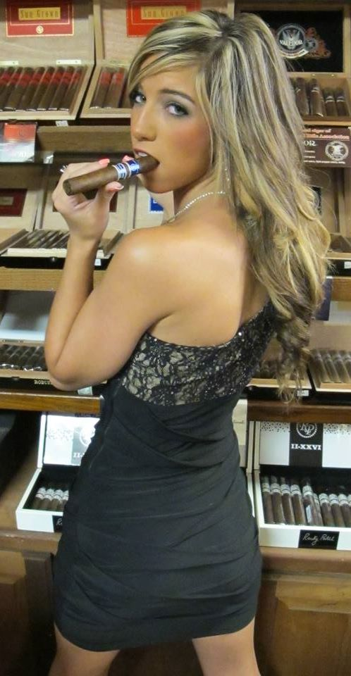 The lovely Courtney Lynn with a great Rocky Patel Cigar!